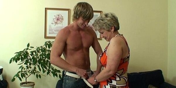 young guy pounds old grandma on the couch
