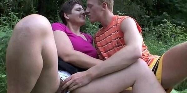 milf fucks his young bf outdoor